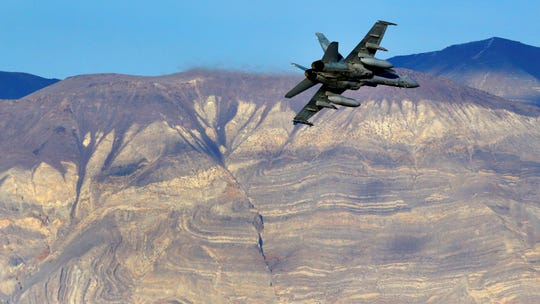 In this Feb. 27, 2017 file photo, an F/A-18D Hornet from the VX-9 Vampire squadron at Naval Air Weapons Station China Lake flies out of what is known as Star Wars Canyon toward the Panamint range in Death Valley National Park. On Wednesday, July 31, 2019, a Navy F/A-18 Super Hornet jet crashed in the California desert.
