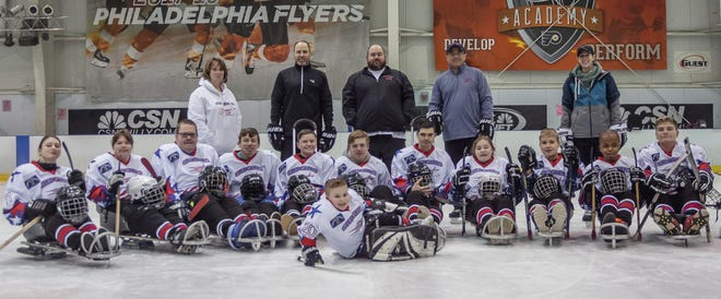 Members and staff of the 2018-19 Weisman Sled Stars hockey team are pictured.
