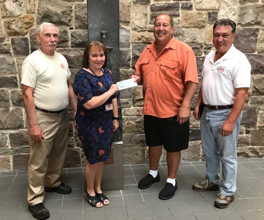 The South Jersey Cruisers Association Car Club recently presented a check to the New Jersey Veterans Memorial Home in Vineland for its activity fund. The donation represented the proceeds from the club's Patriot's Pride Car Cruise, which was held in July on the grounds of Saint Anthony's Greek Orthodox Church Hall. Pictured at the presentation are (from left) Jim Solomon, 50/50 co-coordinator, South Jersey Cruisers Association; Lisa Williams, activities supervisor, New Jersey Veterans Memorial Home; Harry Lombardo, 50/50 co-coordinator, South Jersey Cruisers Association; and Ben Notaro, spokesperson, South Jersey Cruisers Association.