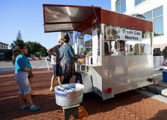 Customers line up outside the Trash Can Nachos stand on Tuesday, July 31, 2019, during Concerts on the Square at 400 Block in Wausau, Wis. Tork Mason/USA TODAY NETWORK-Wisconsin