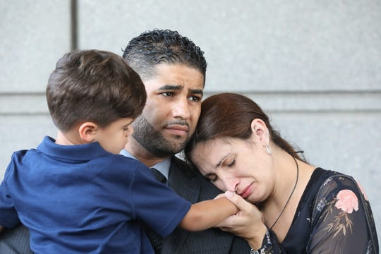 Juan Rodriguez and his wife, Marissa, and son Tristan are pictured outside the Bronx courthouse Aug. 1, 2019.