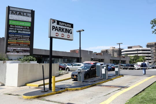 The parking entrance to the White Plains Mall, which currently houses the Department of Motor Vehicles, Aug. 1, 2019. An application submitted for a governmental use permit to relocate the DMV to a building located at 3 Barker Avenue (right) was heavily disputed before being withdrawn completely.