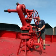 Dan Mosa of Tarrytown is one of the volunteers repairing the Fireboat John D. McKean which is being repaired at the North River Shipyard in Upper Nyack Aug. 1, 2019.