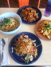 Noodles take center stage at Noodle Hub in Tappan. In front: Pad Woon Sen with chicken, Khao Soi, Pad Thai with tofu and corn salad appetizer.