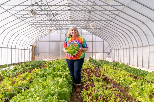 Food Bank CEO Patricia Bebe in the on-site farm at the organization's new headquarters.