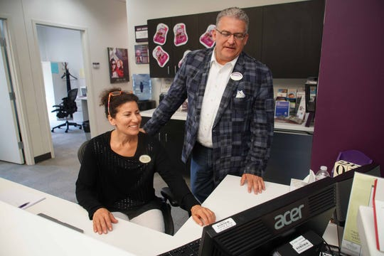 From left, Realtors Julia Capaldi and Michael Wilson work together at Berkshire Hathaway HomeServices Fox & Roach, Realtors at the Concord Pike office.