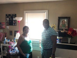 Gwen Yawn, daughter of 70-year-old Beverly Korgere and Johnnie Williams, New Jerusalem Baptist Church deacon, stand in front of an air conditioner installed for Korgere as shown in this Aug. 1, 2019, file photo.