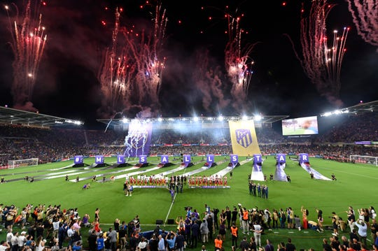 MLS and Atletico Madrid players on the field during introductions before the 2019 MLS All Star Game at Exploria Stadium.