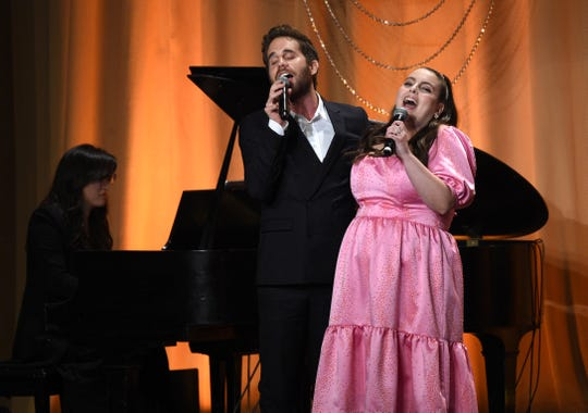 Actor Ben Platt, left, and actress Beanie Feldstein perform together at the 2019 Hollywood Foreign Press Association's Annual Grants Banquet at the Beverly Wilshire Hotel, Wednesday, July 31, 2019, in Beverly Hills, Calif. (Photo by Chris Pizzello/Invision/AP)