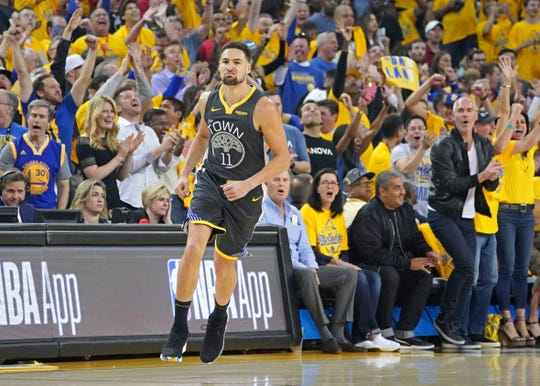 """""""I'm going to come back better and even more athletic,"""" guard Klay Thompson, who is rehabbing after tearing his ACL, said."""