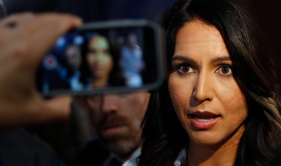 Rep. Tulsi Gabbard, D-Hawaii, answers questions after debate hosted by CNN Thursday, Aug. 1, 2019, in Detroit.