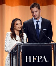Actress Eva Longoria, left, and actor Justin Hartley share the stage at the 2019 Hollywood Foreign Press Association's Annual Grants Banquet at the Beverly Wilshire Hotel, Wednesday, July 31, 2019, in Beverly Hills, Calif. (Photo by Chris Pizzello/Invision/AP)
