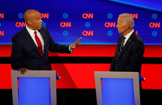 Sen. Cory Booker speaks to former Vice President Joe Biden during the second of two Democratic presidential primary debates on July 31, 2019, in Detroit.