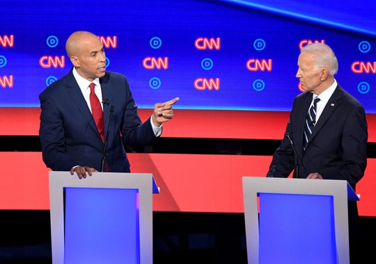 Democratic presidential hopefuls US Senator from New Jersey Cory Booker (L) and Former Vice President Joe Biden (R) speak during the second round of the second Democratic primary debate of the 2020 presidential campaign season hosted by CNN at the Fox Theatre in Detroit, Michigan on July 31, 2019. (Photo by Jim WATSON / AFP)JIM WATSON/AFP/Getty Images