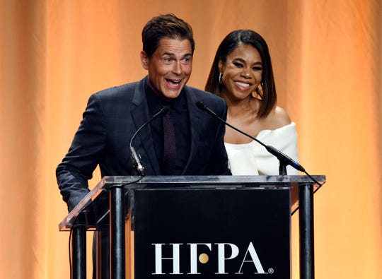 Rob Lowe, left, and actress Regina Hall share a laugh onstage at the 2019 Hollywood Foreign Press Association's Annual Grants Banquet.