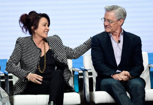 """Carol's Second Act"" stars Patricia Heaton, left, and Kyle MacLachlan share a moment during a CBS panel at the Television Critics Association summer press tour Thursday."