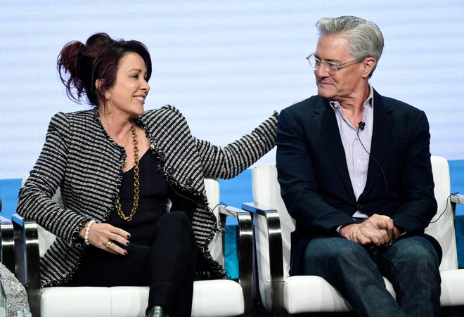 """""""Carol's Second Act"""" stars Patricia Heaton, left, and Kyle MacLachlan share a moment during a CBS panel at the Television Critics Association summer press tour Thursday."""