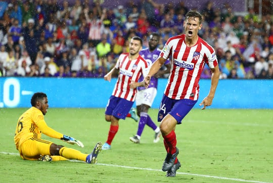 Atletico Madrid midfielder Marcos Llorente celebrates after scoring a goal against the MLS All Star Team in the first half during the 2019 MLS All Star Game at Exploria Stadium in Orlando.