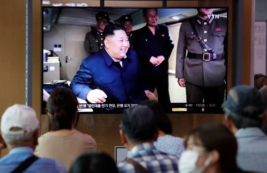 People watch a TV showing an image of North Korean leader Kim Jong Un during a news program at the Seoul Railway Station in Seoul, South Korea, Thursday, Aug. 1, 2019. North Korea said Thursday Kim supervised the first test firing of a new multiple rocket launcher system that could potentially enhance its ability to strike targets in South Korea and U.S. military bases there.