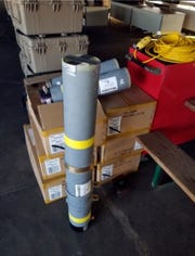 This image released by the Office of the State Fire Marshal's in Maryland, shows a rocket launcher tube that was seized at baggage area.