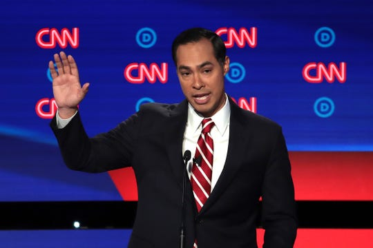 Democratic presidential candidate Julian Castro (C) speaks during the Democratic Presidential Debate at the Fox Theatre July 31, 2019 in Detroit, Michigan.