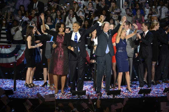 President Barack Obama, first lady Michelle Obama, Vice President Joe Biden and Jill Biden wave at his election night party Wednesday, Nov. 7, 2012, in Chicago. President Obama defeated Republican challenger former Massachusetts Gov. Mitt Romney.