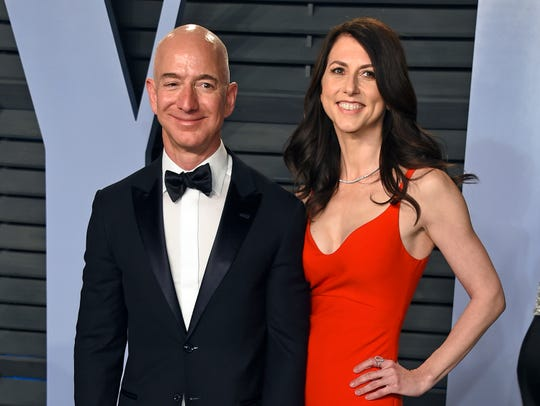 In this March 4, 2018 file photo, Jeff Bezos and wife MacKenzie Bezos arrive at the Vanity Fair Oscar Party in Beverly Hills, Calif.