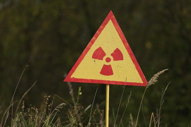 A sign warns of radiation at the site of Kopachi village located inside the Chernobyl Exclusion Zone on Sept. 29, 2015, near Chernobyl, Ukraine.