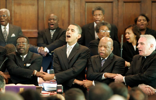 From left: Brown Chapel AME Church pastor James Jackson, Democratic presidential candidate Sen. Barack Obama, D-Ill., Rep. John Lewis, D-Georgia, and Rev. Clete Kiley, hold hands and sing at the end of a church service, Sunday March 4, 2007 in Selma, Ala.