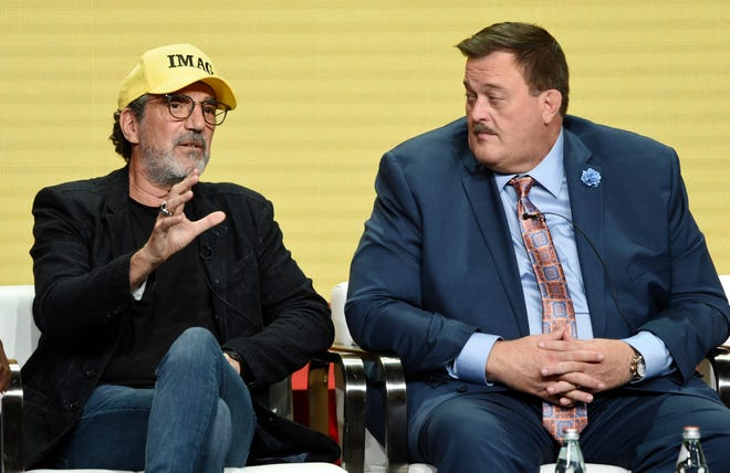 """Chuck Lorre, left, wearing his IMAG (Immigrants Make America Great) cap, talks about his new series, """"Bob Hearts Abishola,"""" which stars Billy Gardell, at the Television Critics Association summer press tour Thursday."""
