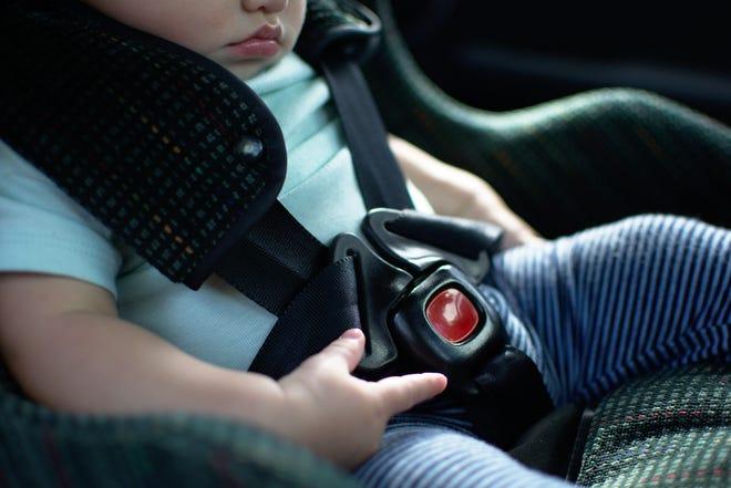 Baby in rear facing car seat.