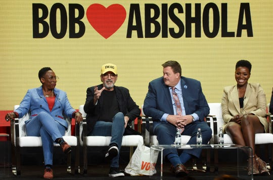 """From left, executive producers Gina Yashere and Chuck Lorre and cast members Billy Gardell and Folake Olowofoyeku take part in a panel discussion on the CBS series """"Bob Hearts Abishola"""" during the Summer 2019 Television Critics Association Press Tour at the Beverly Hilton, Thursday, Aug. 1, 2019, in Beverly Hills, Calif."""