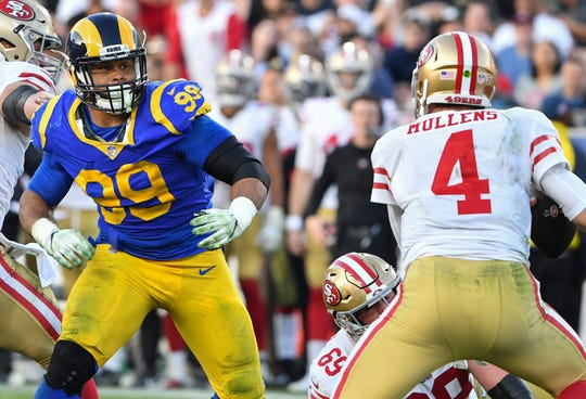 Aaron Donald led the NFL with 20.5 sacks last season.