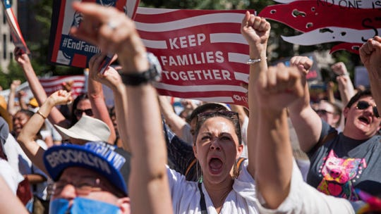 Activists shout during the rally to protest the Trump administration's immigration policies Saturday, June 30, 2018, in New York, New York. (AP Photo/Kevin Hagen) ORG XMIT: NYKH102