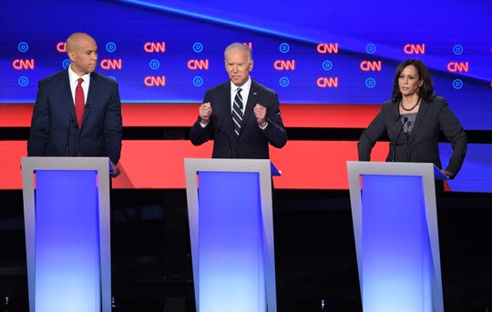 Democratic presidential hopefuls, from left, New Jersey Sen. Cory Booker, former Vice President Joe Biden and California Sen. Kamala Harris speak during the second round of the second Democratic primary debate of the 2020 presidential campaign season hosted by CNN at the Fox Theatre in Detroit on July 31, 2019.