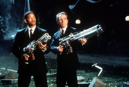 "Will Smith (left) and Tommy Lee Jones keep Earth safe from alien threats in ""Men in Black."""
