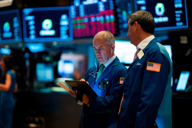 Traders works after the opening bell at the New York Stock Exchange (NYSE) on Wall Street, August 1, 2019, in New York City.