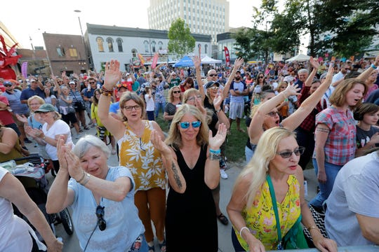 Fans take in a performance at Houdini Plaza in downtown Appleton earlier this month. There'll be two more opportunities to catch live bands on the Houdini stage this year during the Heid Music Summer Concert Series.