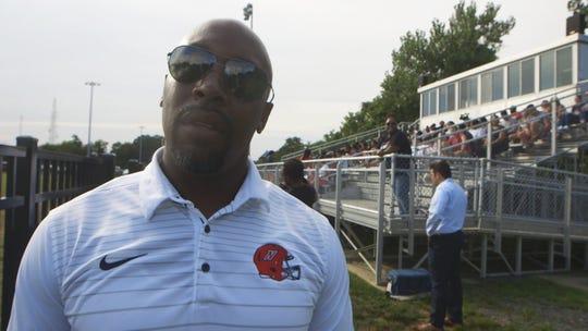 Tariq Holman, Neptune High School's head football coach is a guest speaker at Braeden Bradforth's memorial service.
