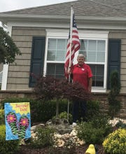 Mike Burtt, who has been battling for the right to install a flag pole in his gated community, is citing federal law in his fight with the homeowner's association.