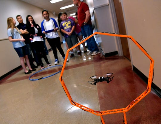 Eighth-grader Vivian Pham pilots a drone through a series of hoops April 4.