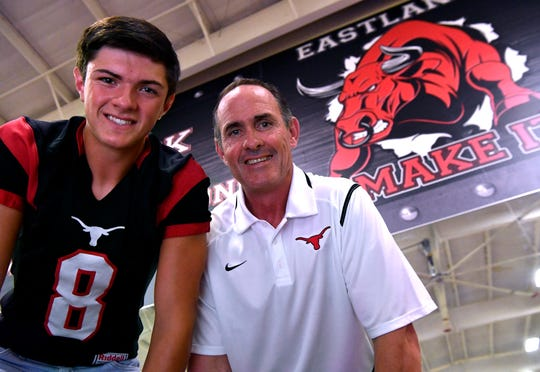 Eastland Mavericks quarterback Behren Morton and his father, Coach James Morton, inside the school's weight room August 1.