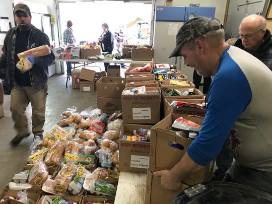 A food distribution at the Beacon of Hope exemplifies how community groups help address food insecurity across Madison County.