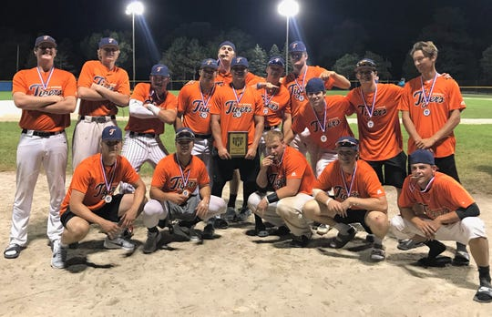 The Mid-Michigan Tigers celebrate winning the City Major League title and earning a spot in the NABF World Series.