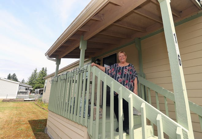 Carol Ungren, 67, stands on the porch of her double-wide manufactured home in the Silverdale Estates mobile home park in East Bremerton on Friday. Ungren is one of thousands to take advantage of the county's property-tax exemption for low-income seniors. Eligibility for the program will expand in 2020.