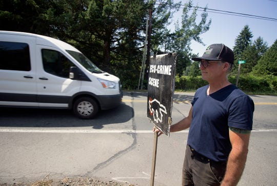Islander Jim Halbrook stands in front of the Reserve at Winslow, protesting the new development on Finch Road on Bainbridge Island.