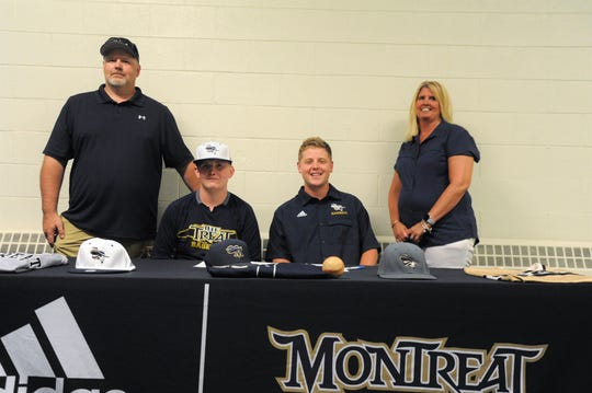 Trenton Messer, seated left, signed to play baseball for Montreat College on July 30 when he was joined by his parents Darren, left, and Donna and Cavaliers assistant coach Grayson Snipes.