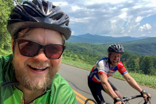 Doug Hay, left, and Griffin Dodd ride along the Blue Ridge Parkway on July 29 when they departed from Boone at 8 a.m. and arrived in downtown Black Mountain 12 hours later.