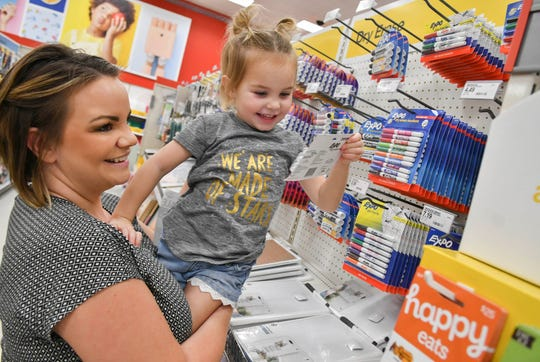 Trish Caupp gets help from her daughter Alexa, 3, as they shop for for school supplies at Target in Viera Friday afternoon.