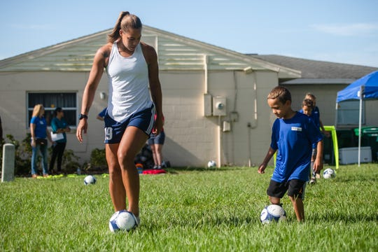 Pro soccer player Toni Pressley of West Shore Jr./Sr. High works with members of the Boys and Girls Club in Melbourne on Thursday in an event sponsored by Health First.